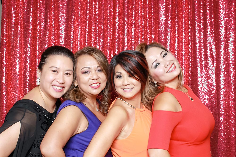 photo booth for anniversary party red backdrop