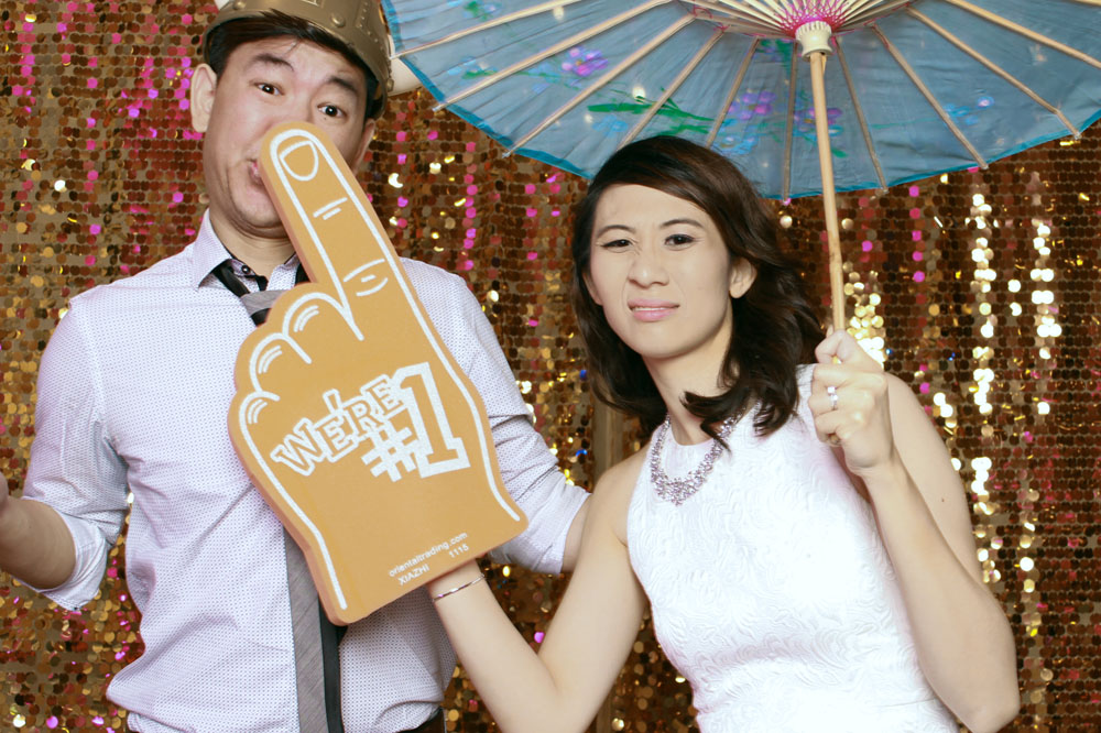 bride and groom photo booth pose